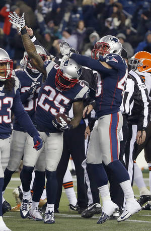 Photo - New England Patriots' Kyle Arrington (25) celebrates with Nate Ebner, right, after he recovered an onside kick by the Cleveland Browns in the fourth quarter of an NFL football game Sunday, Dec. 8, 2013, in Foxborough, Mass. The Patriots came from behind to win 27-26. (AP Photo/Elise Amendola)