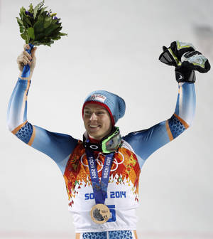 Photo - Men's slalom bronze medal winner, Norway's Henrik Kristoffersen,celebrates on the podium at the Sochi 2014 Winter Olympics, Saturday, Feb. 22, 2014, in Krasnaya Polyana, Russia.  (AP Photo/Christophe Ena)