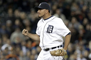 Photo - Detroit Tigers relief pitcher Joaquin Benoit celebrates the final out against the Seattle Mariners in the ninth inning of a baseball game in Detroit, Monday, Sept. 16, 2013. Detroit won 4-2. (AP Photo/Paul Sancya)