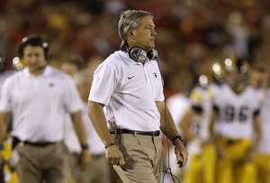 Photo - Iowa head coach Kirk Ferentz looks on during the second half of an NCAA college football game against Iowa State, Saturday, Sept. 14, 2013, in Ames, Iowa. Iowa won 27-21. (AP Photo/Charlie Neibergall)