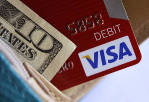 Photo - FILE - This file photo taken Tuesday, May 3, 2011 shows a Visa card in a wallet in Richardson, Texas. Visa reports quarterly earnings on Thursday, Jan. 30, 2014. (AP Photo/LM Otero, File)