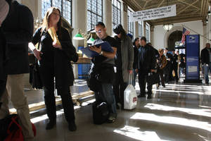 """Photo -   FILE - In this April, 15, 2008, file photo, Jackie Doyle, of Greenwood Lake, N.Y., second from left, waits in line to mail her husband's taxes at the James A. Farley Main Post Office in New York. The package of tax increases and spending cuts known as the """"fiscal cliff"""" takes effect on January 1, 2013, unless Congress passes a budget deal by then. The economy would be hit so hard that it would likely sink into recession in the first half of 2013, economists say. (AP Photo/Tina Fineberg, File)"""