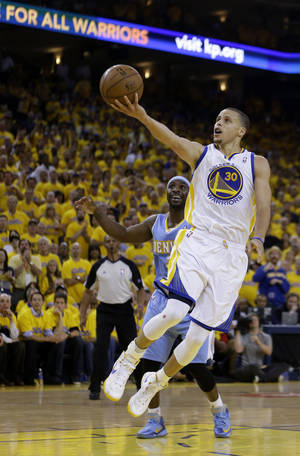 Photo - Golden State Warriors' Stephen Curry lays up a shot during the second half of Game 6 in a first-round NBA basketball playoff series against the Denver Nuggets on Thursday, May 2, 2013, in Oakland, Calif. (AP Photo/Ben Margot)