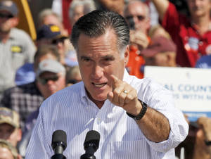 Photo -   Republican presidential candidate, former Massachusetts Gov. Mitt Romney gestures during a rally in Abingdon, Va., Friday, Oct. 5, 2012.(AP Photo/Steve Helber)