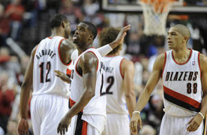 Photo - Portland Trail Blazers'  Wesley Matthews, center, celebrates a three point shot during the second half of an NBA basketball game against the Houston Rockets in Portland, Ore.,Thursday Dec. 12, 2013. Portland beat the Rockets 111-104. (AP Photo/Greg Wahl-Stephens)