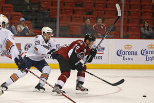 Photo - Chris VandeVelde of the Oklahoma City Barons chases Bryan Lerg of the Lake Erie Monsters during AHL hockey game at the Cox Convention Center in Oklahoma City, Tuesday, October 23, 2012. Photo by Bryan Terry, The Oklahoman