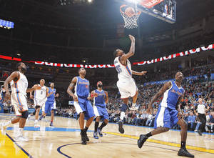 Photo - Oklahoma City's Kevin Durant (35) shoots a lay up during the Thunder's 101-93 loss to the Los Angeles Clippers on Sunday at the Ford Center. The Thunder is 5-5 through its first 10 games.  PHOTO BY SARAH PHIPPS, THE OKLAHOMAN