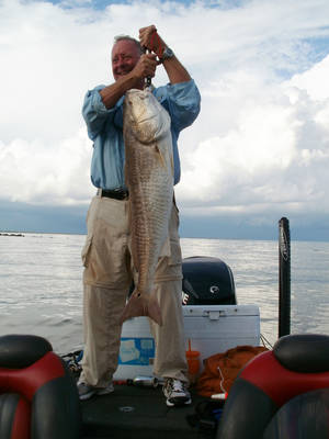 "photo - Oklahoma Supreme Court Justice Joseph Watt caught this 35-pound redfish off the coast of Venice, La. The red fish outweighed his previous biggest three catches of redfish combined. ""Years ago, I would catch redfish down on the Texas Coast but rarely would a big one weigh 12 pounds,"" Watt said. ""One like that won't even get a nod in Venice."" The coastal waters near Venice, La., are believed by many to be among the best angling destinations in North America. Photo provided by Gary Giudice"