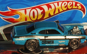 photo - FILE - In this Oct. 13, 2011 file photo, a Mattel Hot Wheels toy car is displayed in Portland, Ore. Toy maker Mattel Inc. said Monday, April 16, 2012, their first-quarter profit dropped 53 percent, pulled down by costs tied to an acquisition and lower sales for Barbie and Hot Wheels. (AP Photo/Rick Bowmer, File)