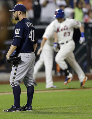 Photo - Milwaukee Brewers starting pitcher Marco Estrada (41) reacts as New York Mets' Taylor Teagarden (23) runs the bases after hitting a grand slam home run during the sixth inning of a baseball game Tuesday, June 10, 2014, in New York. (AP Photo/Frank Franklin II)