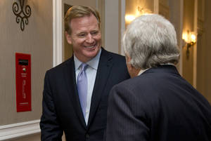 Photo - NFL Commissioner Roger Goodell, left, and New England Patriots football team owner Robert Kraft talk as they arrive for the NFL fall meeting in Washington, Tuesday, Oct. 8, 2013. (AP Photo/Carolyn Kaster)