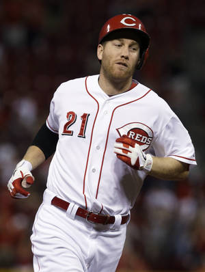 Photo - Cincinnati Reds' Todd Frazier rounds the bases after hitting a solo home run off St. Louis Cardinals starting pitcher Lance Lynn in the third inning of a baseball game, Thursday, Sept. 5, 2013, in Cincinnati. (AP Photo/Al Behrman)