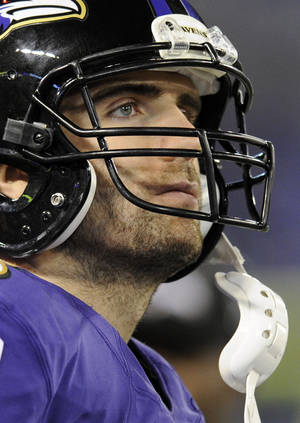 Photo - Baltimore Ravens quarterback Joe Flacco watches action in the final moments of an NFL football game against the New England Patriots, Sunday, Dec. 22, 2013, in Baltimore. New England won 41-7. (AP Photo/Nick Wass)