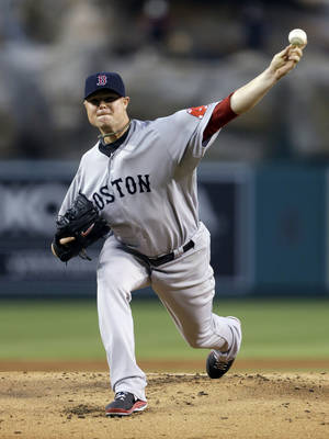 Photo -   Boston Red Sox starting pitcher Jon Lester throws to the Los Angeles Angels during the first inning of an baseball in Anaheim, Calif., Thursday, Aug. 30, 2012. (AP Photo/Chris Carlson)