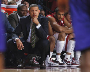 Photo - Sooner head coach Jeff Capel watches his team in the first half as the University of Oklahoma Sooner (OU) men's college basketball team plays the University of Central Arkansas Bears (UCA) at the Lloyd Noble Center on Thursday, December 30, 2010, in Norman, Okla. Photo by Steve Sisney, The Oklahoman