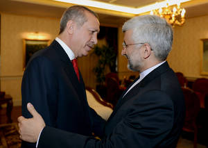 "Photo -   In this photo provided by Turkish Prime Minister's Press Service, Turkish Prime Minister Recep Tayyip Erdogan, left, greets Iran's chief nuclear negotiator Saeed Jalili before a meeting in Ankara, Turkey, Tuesday, Sept. 18, 2012. Iran on Tuesday urged Western powers to engage in ""purposeful"" negotiations as top EU and Iranian representatives prepared to meet for talks on restarting stalled negotiations over Tehran's nuclear program. The EU's Foreign policy Chief Catherine Ashton and Jalili are meeting in Istanbul later on Tuesday. (AP Photo/Yasin Bulbul, Prime Minister's Press Service)"