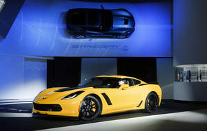 Photo - The 2015 Chevrolet Corvette Z06 is unveiled at media previews during the North American International Auto Show in Detroit, Monday, Jan. 13, 2014. (AP Photo/Paul Sancya)