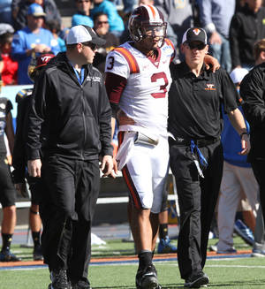 Photo - Virginia Tech quarterback Logan Thomas is helped off the field after being shaken up during the second quarter against UCLA in the Sun Bowl NCAA college football game Tuesday Dec. 31, 2013, in El Paso, Texas. (AP Photo/Victor Calzada)