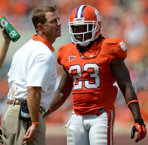 Photo -   Clemson head Dabo Swinney directs his team from the sidelines as Andre Ellington (23) returns to the bench during an NCAA college football game against Ball State Saturday, Sept. 8, 2012 at Memorial Stadium in Clemson S.C. (AP Photo/ Richard Shiro)