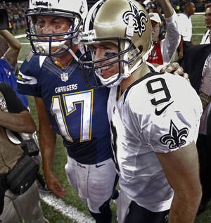 Photo -   New Orleans Saints quarterback Drew Brees (9) and San Diego Chargers quarterback Philip Rivers (17) greet each other after their NFL football game in New Orleans, Sunday, Oct. 7, 2012. The Saints won 31-24. (AP Photo/Bill Haber)