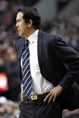 photo - Miami Heat coach Erik Spoelstra watches from the bench during the first quarter of an NBA basketball game against the Portland Trail Blazers in Portland, Ore., Thursday, Jan. 10, 2013. (AP Photo/Don Ryan)