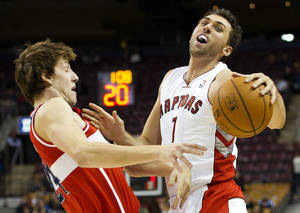 Photo -   Toronto Raptors forward Andrea Bargnani, right, collides with Washington Wizards forward Jan Vesely, left, during the first half of their preseason NBA basketball game, Wednesday, Oct. 17, 2012, in Toronto. (AP Photo/The Canadian Press, Nathan Denette)