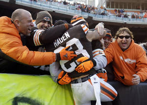 Photo -   Cleveland Browns cornerback Joe Haden (23) is hugged by fans after a 20-14 win over the Pittsburgh Steelers in an NFL football game on Sunday, Nov. 25, 2012, in Cleveland. (AP Photo/Mark Duncan)