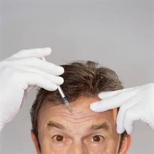 Photo - Today's men are getting a makeover, prettifying themselves with such gusto that they're driving big increases in national skin-care sales and flooding dermatologists' offices with record-high requests for wrinkle smoothers, laser treatments and derma fillers.