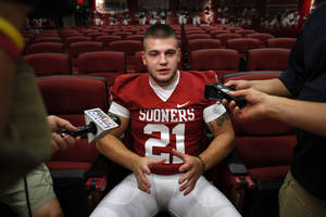 photo - OU COLLEGE FOOTBALL: Tom Wort (21) speaks with the media during the Meet the Sooners event at the University of Oklahoma on Saturday, Aug. 4, 2012, in Norman, Okla.  Photo by Steve Sisney, The Oklahoman