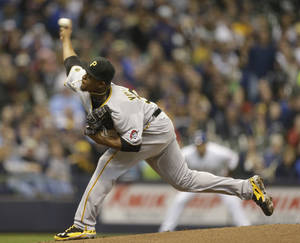 Photo - Pittsburgh Pirates starting pitcher Edinson Volquez throws against the Milwaukee Brewers during the first inning of a baseball game Saturday, April 12, 2014, in Milwaukee. (AP Photo/Jeffrey Phelps)