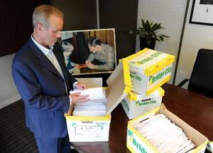 photo - In this Tuesday, Oct., 16, 2012 photo, Portland attorney Kelly Clark examines some of the 14,500 pages of previously confidential documents created by the Boy Scouts of America concerning child sexual abuse within the organization, in preparation for releasing the documents Thursday, Oct. 18, in his office in Portland, Ore. The Boy Scouts of America fought to keep those files confidential. (AP Photo/Greg Wahl-Stephens)