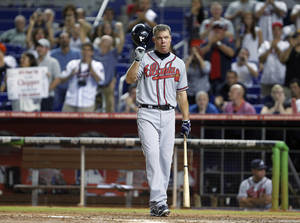 photo -   Atlanta Braves' Chipper Jones tips his helmet to the crowd after it gave him a standing ovation on his last at-bat of a baseball game against the Miami Marlins, in the eighth inning Wednesday, Sept. 19, 2012, in Miami. Jones is retiring after the season. The Braves beat the Marlins 3-0. (AP Photo/Wilfredo Lee)