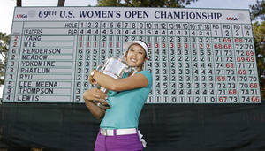 Photo - Michelle Wie poses with the trophy after winning the U.S. Women's Open golf tournament in Pinehurst, N.C., Sunday, June 22, 2014. (AP Photo/Bob Leverone)