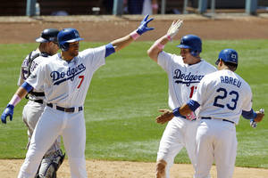 Photo -   Los Angeles Dodgers' A.J. Ellis, center, celebrates his three-run home run with James Loney, left, and Bobby Abreu against the Colorado Rockies during the fifth inning of a baseball game in Los Angeles, Sunday, May 13, 2012. (AP Photo/Chris Carlson)
