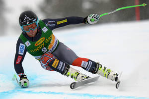 Photo - Andrew Weibrecht skis during the men's World Cup super-G ski race in Lake Louise, Alberta, Sunday, Dec. 1, 2013. (AP Photo/The Canadian Press, Jonathan Hayward)
