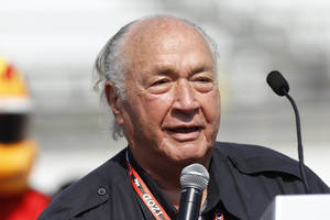 Photo - FILE - In this May 29, 2010, file photo, Indy 500 legend Andy Granatelli speaks during the drivers meeting for the Indianapolis 500 auto race at the Indianapolis Motor Speedway in Indianapolis. Granatelli, the former CEO of STP motor oil company who made a mark on motorsports as a car owner, innovator and entrepreneur, died Sunday, Dec. 29, 2013.  He was 90. (AP Photo/Mike Groll, File)
