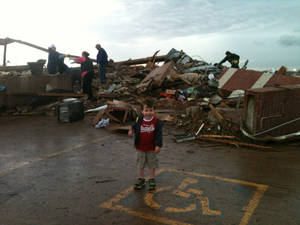 Brendan Workman, 3, stands in front of what's left of his school. Brendan and his mother, Shannon, were inside A Step Above Learning Center in south Oklahoma City when the torando struck the building. <strong>PROVIDED - PROVIDED</strong>