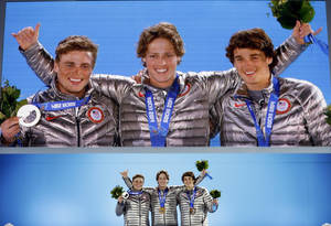 Photo - Men's slopestyle skiing medalists, from left, Gus Kenworthy, silver, Joss Christensen, gold, and Nicholas Goepper, bronze, all from the United States, pose with their medals at the 2014 Winter Olympics in Sochi, Russia, Thursday, Feb. 13, 2014.  (AP Photo/David Goldman)