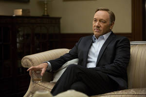 "Photo - This image released by Netflix shows Kevin Spacey in a scene from the Netflix original series, ""House of Cards,"" an adaptation of a British classic. (AP Photo/Netflix, Melinda Sue Gordon)"
