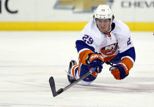 Photo - New York Islanders' Brock Nelson (29) dives for the puck during the first period of an NHL hockey game against the Carolina Hurricanes in Raleigh, N.C., Tuesday, March 25, 2014. (AP Photo/Karl B DeBlaker)