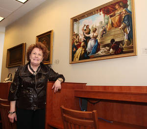 Photo - Bobbie Burbridge Lane poses with a painting from the collection she donated to Oklahoma City University and dedicated to seven of her special friends. Photo by David Faytinger, The Oklahoman