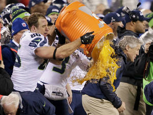 Photo - Seattle Seahawks' Zach Miller dumps Gatorade on Seattle Seahawks head coach Pete Carroll during the second half of the NFL Super Bowl XLVIII football game Sunday, Feb. 2, 2014, in East Rutherford, N.J. The Seahawks won 43-8. (AP Photo/Gregory Bull)