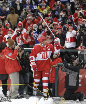 Photo - Detroit Red Wings forward Steve Yzerman is introduced before the Winter Classic alumni outdoor NHL hockey game at Comerica Park in Detroit, Tuesday, Dec. 31, 2013. (AP Photo/Carlos Osorio)