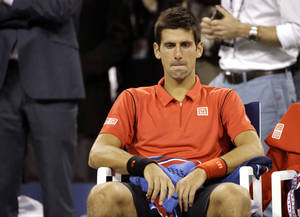 Photo - Novak Djokovic, of Serbia, sits in his changeover chair after losing to Rafael Nadal, of Spain, in the men's singles final of the 2013 U.S. Open tennis tournament, Monday, Sept. 9, 2013, in New York. (AP Photo/David Goldman)