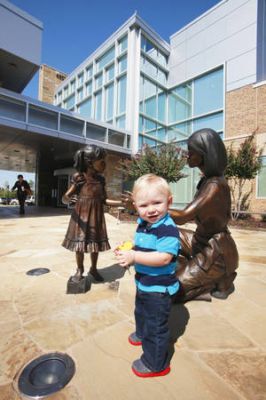 Photo - Ryson Wilson, who turns 1 on Thursday, stands outside Integris Health Edmond. He was the first baby born at the 40-bed hospital.  PHOTO BY PAUL B. SOUTHERLAND, THE OKLAHOMAN