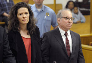 Photo - FILE - In this May 16, 2014 file photo, Paul Simon, right, and his wife, Edie Brickell, make a brief appearance in Superior Court in Norwalk, Conn., for a disorderly conduct case about an April 26 argument inside a cottage on their New Canaan property. The couple had been scheduled to return to court Tuesday, June 17, 2014, but prosecutors declined to pursue the case. The charges will be dropped and eventually erased after 13 months. (AP Photo/New York Post, Douglas Healey, Pool, File)