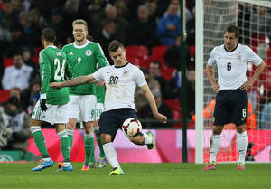 Photo - England's Jack Wilshere, center, kicks the ball away in frustration after loosing to Germany at the end of the international friendly soccer match between England and Germany, at Wembley Stadium in London, Tuesday, Nov. 19, 2013. (AP Photo/Alastair Grant)