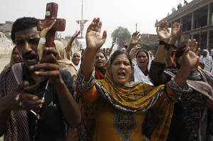 Photo - Pakistani Christians chant slogans during a protest to condemn a suicide bombing on a church, in Peshawar,  Pakistan, Monday, Sept. 23, 2013. Angry Pakistani Christians denounced the deadliest attack ever in this country against members of their faith. A pair of suicide bombers blew themselves up amid hundreds of worshippers outside a historic church in northwestern Pakistan. (AP Photo/Mohammad Sajjad)