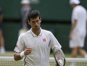 Photo - Novak Djokovic of Serbia reacts during his Men's singles match against Tommy Haas of Germany at the All England Lawn Tennis Championships in Wimbledon, London, Monday, July 1, 2013. (AP Photo/Anja Niedringhaus)