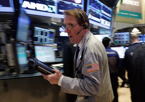 Photo - Trader Luke Scanlon rushes across the floor of the New York Stock Exchange Monday, March 25, 2013.  U.S. stock markets are opening higher after Cyprus clinched a last-minute bailout that saved it from bankruptcy. (AP Photo/Richard Drew)